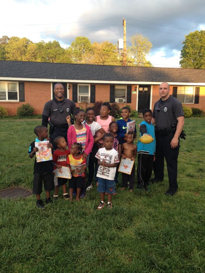 Community Policing Officers with Children